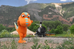 A T-rex and train walk into a bar... (Copyright Durango & Silverton Narrow Gauge Railroad.)