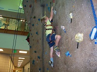 "This kid is rocking it on the climbing wall. ""Rocking"" -- get it?! Er..."