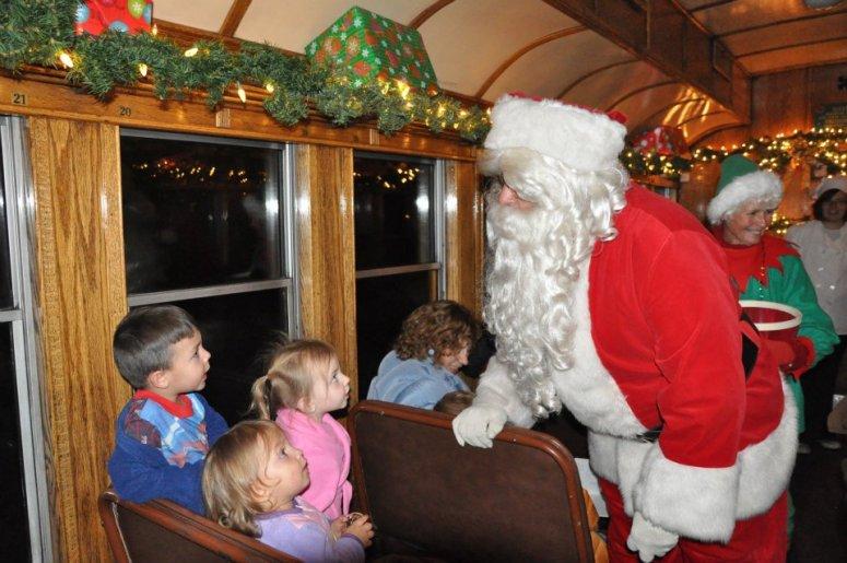 Santa greets passengers aboard Durango and Silverton Narrow Gauge Railroad's Polar Express train.